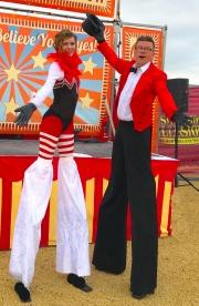 Circus Ringmaster and Showgirl Stiltwalkers